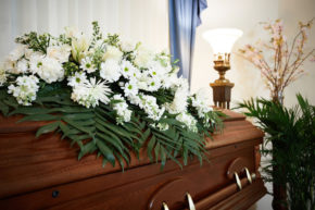 Flowers on top of Casket